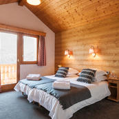 Generous sized quad bedroom with adjoining annex, sleeps 4 in our 3 matching chalets: Foehn, Covie or Charmille.