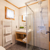 Our trio of matching chalets, Foehn, Covie & Charmilles all have smart ensuite shower rooms.