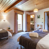 Chalet Charmille's generous sized top floor room  sleeps 3/4 ideal for a group of friends or family of 4.