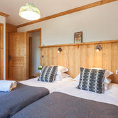 Chalet Foehn's ground floor bedrooms all with ensuite shower rooms.