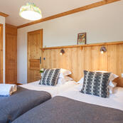 One of the large twin bedrooms in chalets Foehn, Covie and Charmille