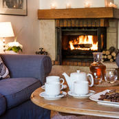 Relax by La Vieille Scierie's open log fire after a dip in the jacuzzi