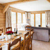 Chalet Les Sauges large picture windows offer direct access to sundeck and hot tub.
