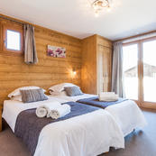 Chalet Les Sauges spacious bedrooms and bright picture windows