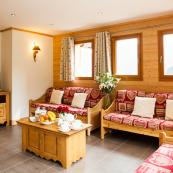 Enjoy stunning views from Chalet L'Erine's lovely living room, which leads to sun deck and hot tub.