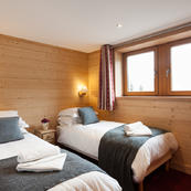 Warmly furnished bedrooms, in a contemporary alpine style