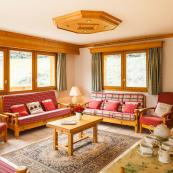 Chalet Foehn's lovely bright living room leads to sun deck with hot tub.