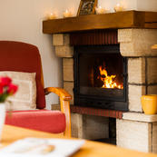 Snuggle up by Chalet Covie's open log fire.