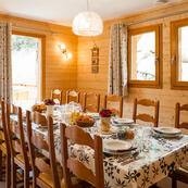 Enjoy a delicious breakfast and evening meal at this warm and welcoming table in chalet L'Erine