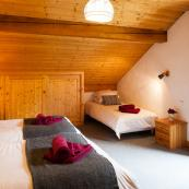 Chalet Foehn's top floor rooms are spacious and comfortably sleep 3/4.