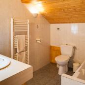 Chalet Foehn's top floor bedrooms are with full ensuite bathrooms, bath, shower attachment, sink & wc.